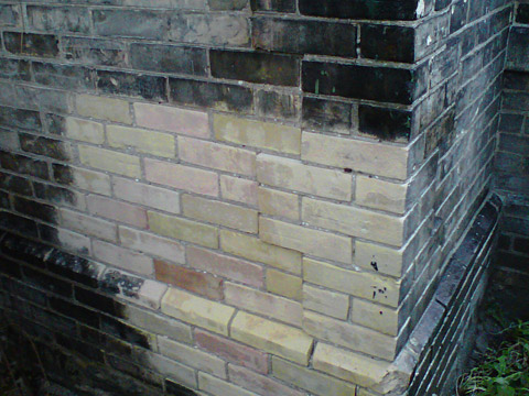 Exterior yellow brick wet blast cleaning